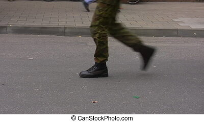 Soldiers marching - Soldier formation wearing camouflage...