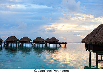 Over water villas at sunset