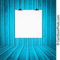 Blank board hanging at wall in blue retro room
