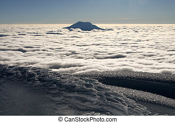 over the clouds - great view from the summit of cotopaxi,...