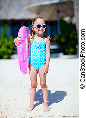 Little girl at tropical beach - Portrait of cute little girl...