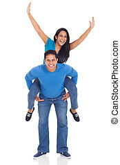 loving couple having fun with piggyback ride - portrait of...