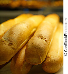 Whole Loaves of French Bread in a Bakery