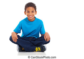african american boy sitting on white background - cute...