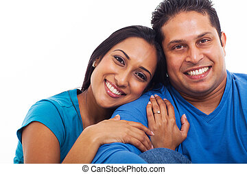 lovely indian husband and wife portrait, isolated on white