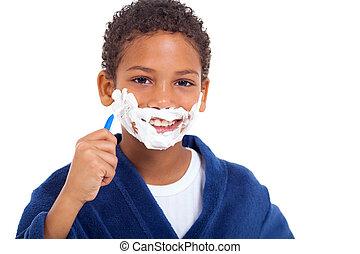 playful little african boy shaving - playful little african...