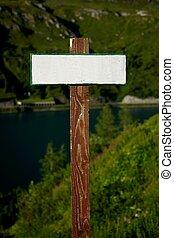 Signboard - Blank, empty signpost in a mountain landscape