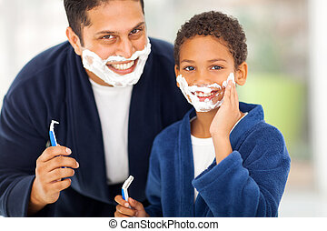 son playing with father's shaving foam - happy son playing...