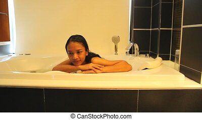 woman relaxing in a Jacuzzi - Footage Young woman relaxing...
