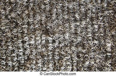 Gray Carpet - Closeup shot of rough looking gray carpet.