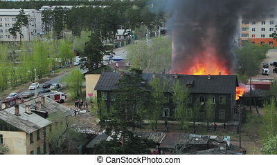 Wooden residential house in fire. Russia