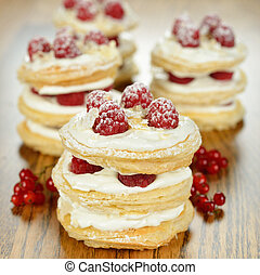 Millefeuille with raspberry  on a brown table