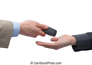 Car buying - Close up of a male hand taking car key