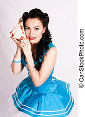 Sailor pin up girl with a shell.