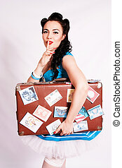 Sailor pin up girl with a suitcase.