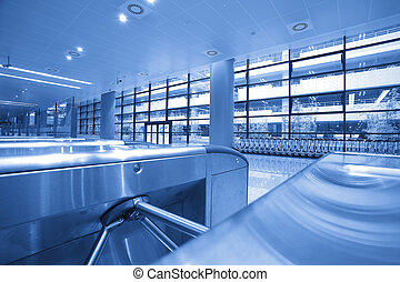interior of the modern architectural at subway turnstile...