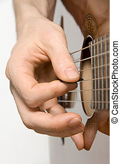 Picking the acoustic guitar - Right hand of guitar player...
