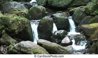 idyllic mountain stream in ireland - idyllic mountain stream...