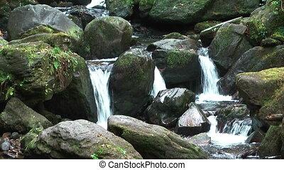 idyllic mountain stream in ireland - idyllic mountain stream...