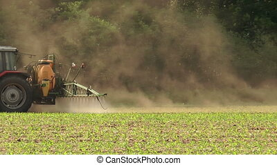 spraying pesticides closeup - farmer spraying pesticides...