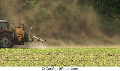 spraying pesticides closeup - farmer spraying pesticides...