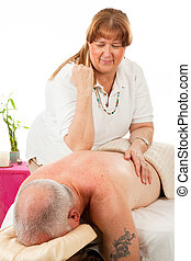 Relaxing Massage - Mature man enjoys a relaxing massage from...