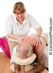 Therapeutic Massage - Mature man enjoying a therapeutic...