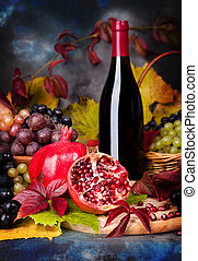 Beautiful still life with wine glasses, grapes, pomegranate...