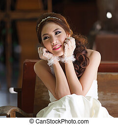 Young Asian lady in white bride dress, Model is Thai...
