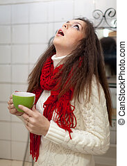 Colds woman gargling throat in her bathroom at home