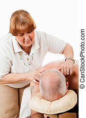 Massaging Tense Shoulders - Massage therapist works on...
