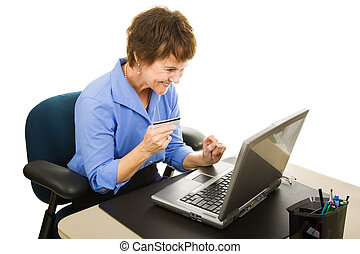 Online Shoping at Work - Businesswoman shopping online while...
