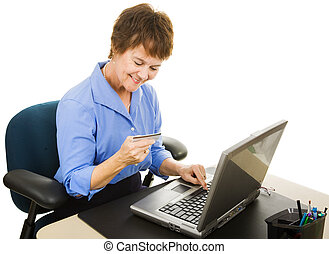 Internet Shopping - Mature office worker takes a few minutes...