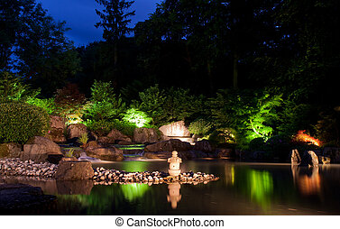 Waterfall in japanese garden at night