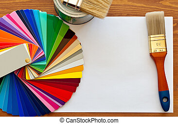 color samples and paint brushes on the wooden table with...