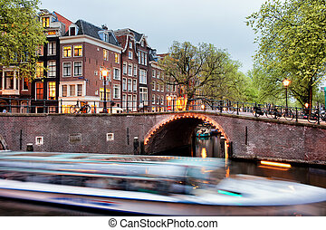 Canal Bridge and Boat Tour in Amsterdam at Evening - Canal...