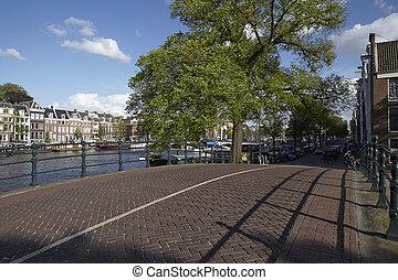 Amsterdam, Netherlands - Street along a canal