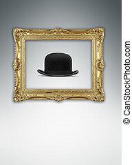 old golden frame with bowler hat inside