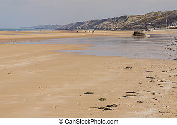 Omaha beach, - Normandy, France. - Golden sandy Omaha beach...