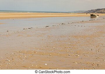 Omaha beach, - Normandy, France - Golden sandy Omaha beach...