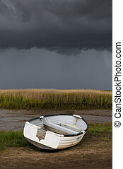 Single white rowing boat at Brancaster Norfolk England
