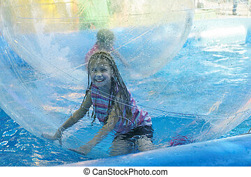 Attraction on the water - aquazorbing - Girl on roller...