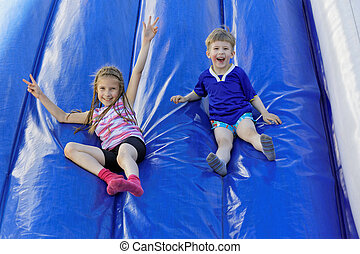 The joy of entertainment - Funny kids and off the inflatable...