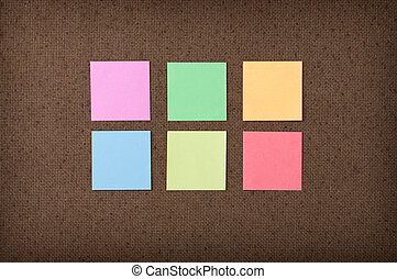 Sticky notes on fiberboard background - Six colorful sticky...