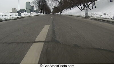 Driving on urban highway, close-up - Driving on snowy urban...