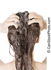 Young woman in shower washing her hairs isolated on white...
