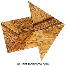 tangram arrow - abstract picture of an arrow built from...