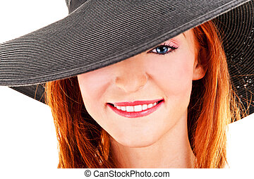 Portrait of beautiful young woman wearing black hat