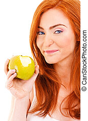 Red hair woman eat green apple on white