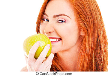 Red hair woman with green apple on white